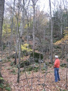 man standing among boulder field in fall