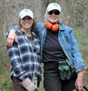 TerraCorps members Brigid and Susan in the woods during a trailwork day