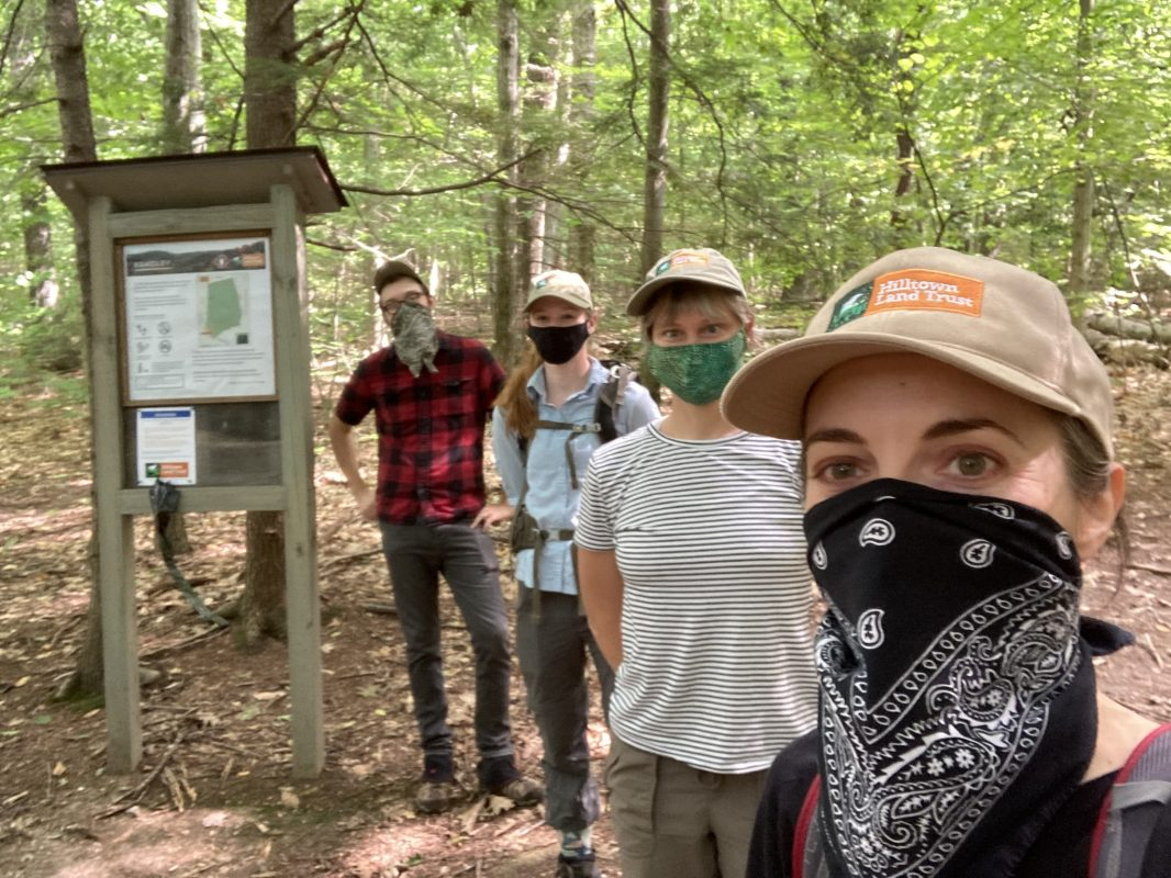 HLT staff and TerraCorps members wearing masks at the new Bradley property kiosk