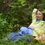 Nadine, reclining in the woods