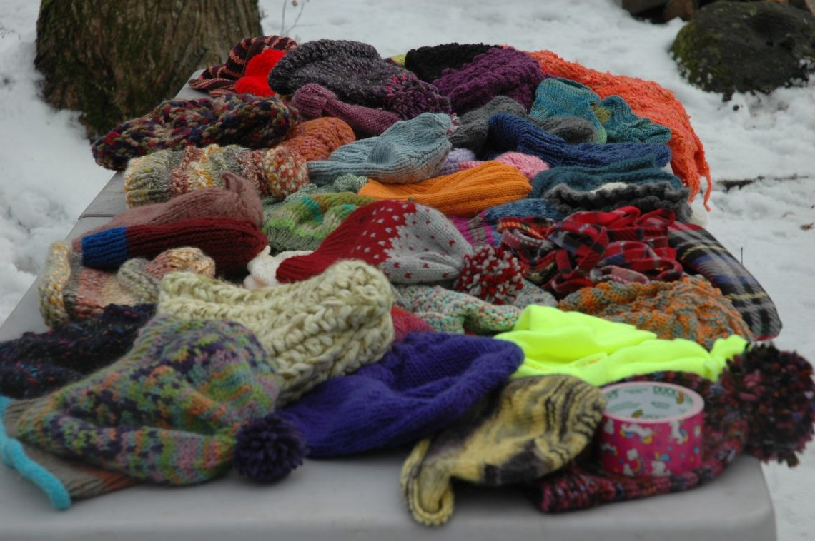 A table full of hand-knit hats at the Gorge après Gorge.