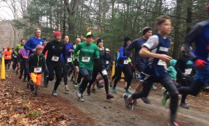A large group of runners departs the starting line at the Gorge après Gorge.